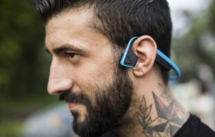 A man with bluetooth headphones